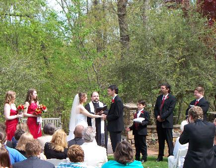Fr. Geof preforming a lovely outdoor wedding.