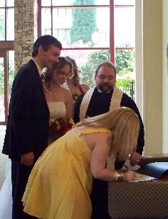 A wedding party signing the couple's Certificate.